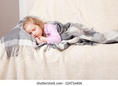 Illness sleeping girl at home. Child