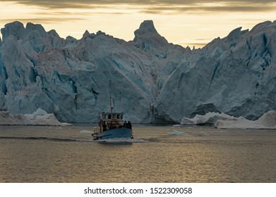 ILLULISAT, DISCO BAY/GREENLAND - September 22, 2019:  Expedition boat in the Disko bay nearby of Ilulissat, Greenland. Site is the favourite destination for whale watching and Iceberg exploration.
