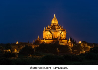 Illuminated Bagan temple at night in Myanmar.
