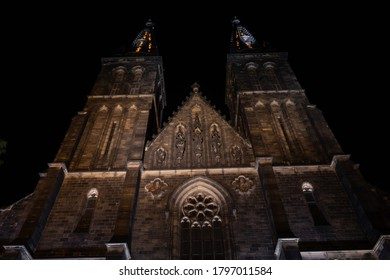 illuminated Basilica of St. Peter and Paul in Prague Vysehrad at night. basilica towers. reconstruction from the 19th century