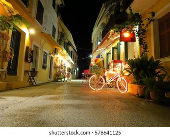 Illuminated bicycle in a street of Gaios village at night, Paxos, Ionian islands