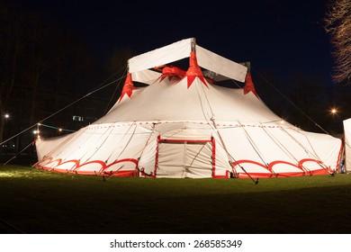 Illuminated big top circus tent at night