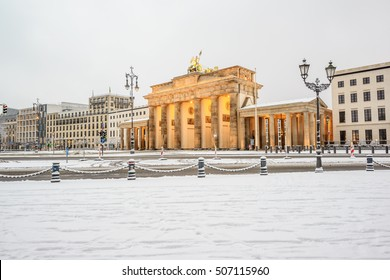 illuminated Brandenburg gate (Brandenburger Tor) and 18th of March Square in snow, Berlin, Germany, Europe