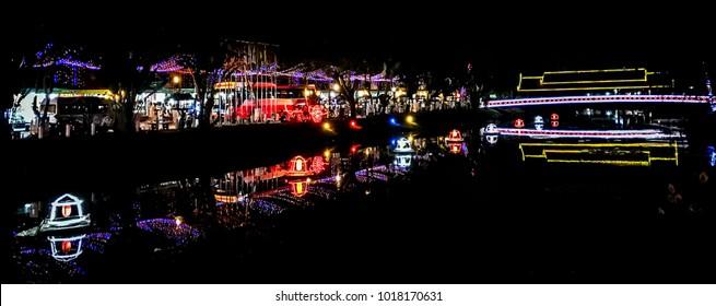 Illuminated bridge and night market in Siem Reap, Cambodia. Photo taken in 2017.