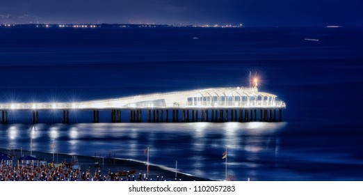 illuminated bridge in the night on the sea