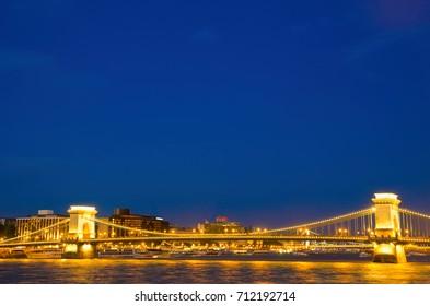 illuminated Budapest bridge at night