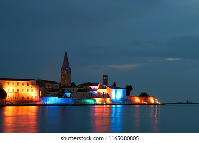 illuminated buildings in the historic old town of Porec in Croatia