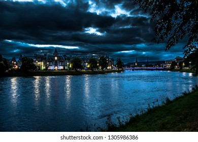 Illuminated Buildings In The Scenic Streets Of The City Of Inverness At The River Ness At Night in Scotland