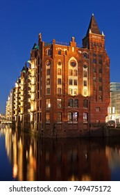 Illuminated buildings in the Speicherstadt, a historic warehouse district, in Hamburg, Germany at night