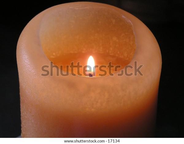 An illuminated candle.