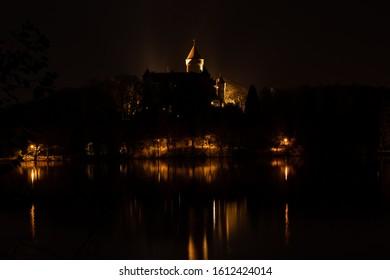 Illuminated castle Konopiste; Osvětlený zámek Konopiště; Castle reflection in water surface; odraz hradu na hladině rybníka - Shutterstock ID 1612424014