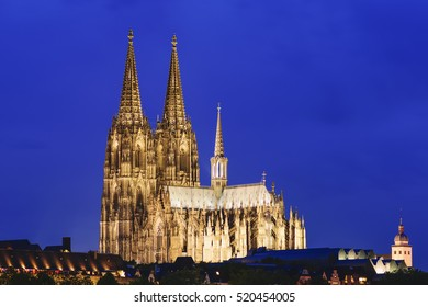 Illuminated cathedral of Cologne in the night, Germany