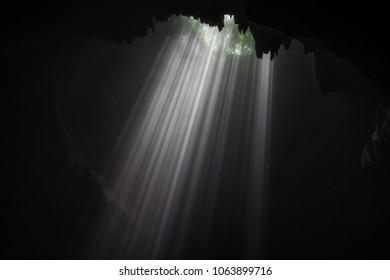 Illuminated cave at Goa Jomblang Tour near Yogyakarta, Indonesia