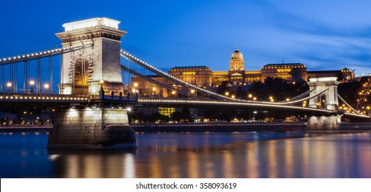 Illuminated Chain bridge and Castle in a twilight blue sky evening, Budapest, Hungary