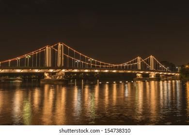 Illuminated Chelsea Bridge at night, London, UK