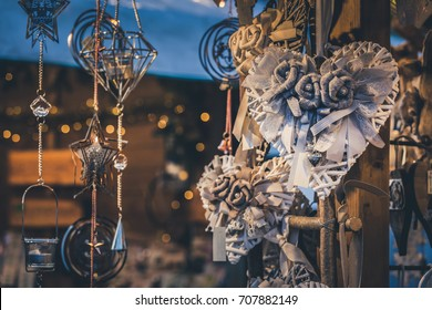 Illuminated Christmas fair kiosk with handcrafted xmas decorations, mercatino di Natale in Trento