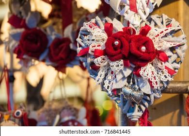 Illuminated Christmas fair kiosk with handcrafted xmas decorations, mercatino di Natale in Trento