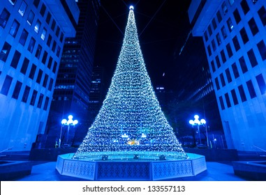 Illuminated Christmas tree in Montreal. (Night scene in blue tone)