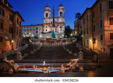 Illuminated Christmas tree in Piazza di Spagna at night, Rome, Italy