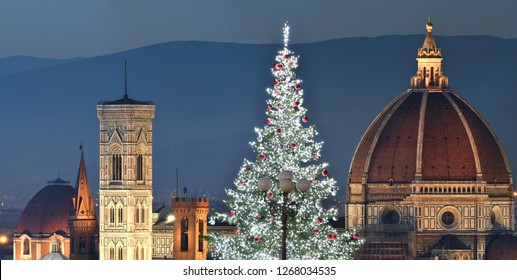 Illuminated Christmas Tree at Piazzale Michelangelo with the Cathedral of Santa Maria del Fiore on background. Italy