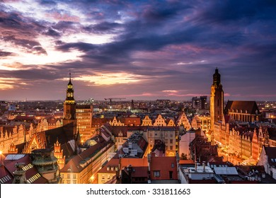Illuminated city skyline at night, Wroclaw, Poland, Europe.