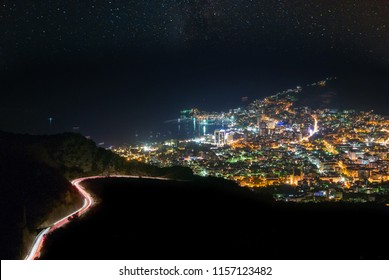 Illuminated city under starry sky, Budva, Adriatic coast