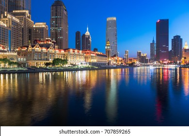 illuminated city waterfront downtown skyline with Haihe river,Tianjin,China.