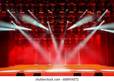 Illuminated concert stage without people, with red light and stage fog