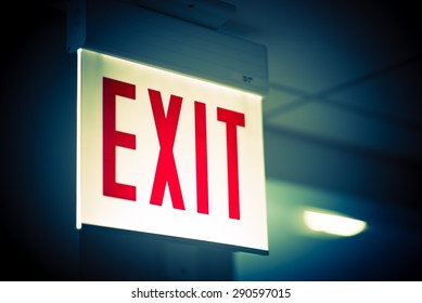 Illuminated Corporate Office Exit Sign Closeup.