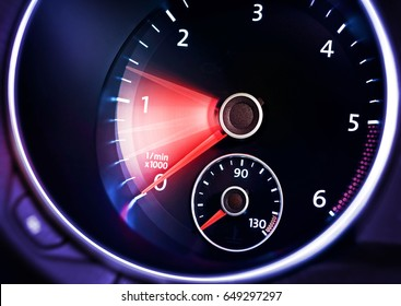 illuminated dashboard with tachometer of car
