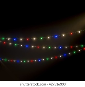 Illuminated decorative lighting for UAE national day celebration. Christmas lights in UAE national flag colors.