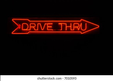 Illuminated drive thru neon sign with arrow pointing right