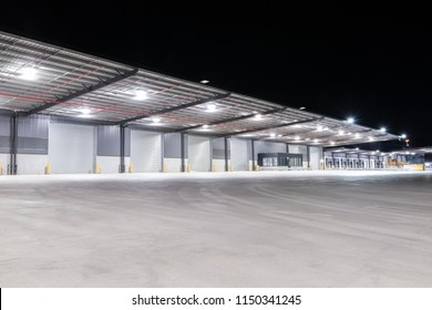 Illuminated exterior of a factory, industrial style building. Night time.