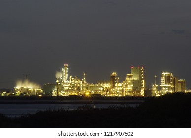 An illuminated factory in the evening