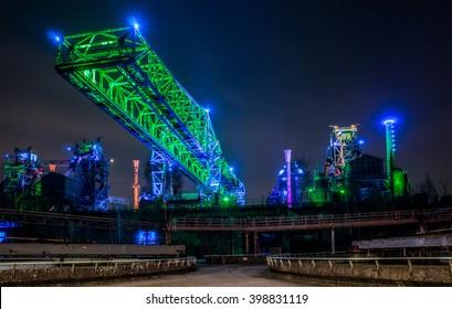 Illuminated factory plant at night
