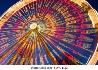 Illuminated ferris wheel in night