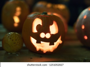 Illuminated figures made of pumpkins. Halloween night.