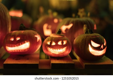 Illuminated figures made of pumpkins. Helloween night.
