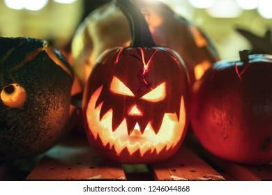 Illuminated figures from pumpkins. Helloween night.