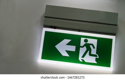 Illuminated fire or emergency exit sign board or glass