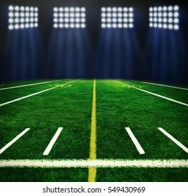 Illuminated football field at night