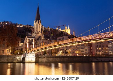 Illuminated footbridge over the Saone river in Vieux Lyon at dusk. Lyon,  France.