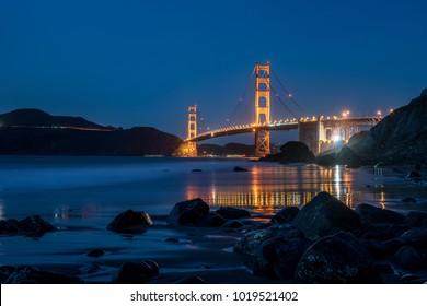 Illuminated Golden Gate Bridge in San Francisco in California USA. Long exposure panoramic photo. Horizontal.