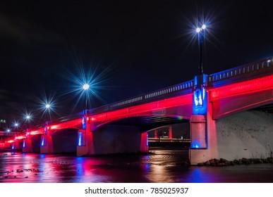 Illuminated highway bridge in Dayton, Ohio at night