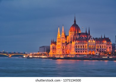 Illuminated Hungarian Parliament with a Danube river in Budapest at night. Hungary
