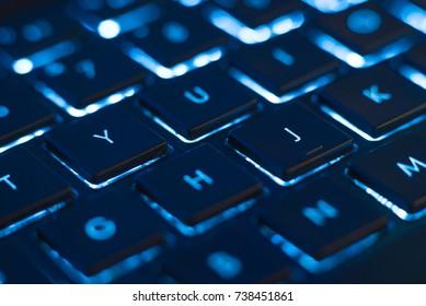 Illuminated keyboard closeup. Hi tech concept