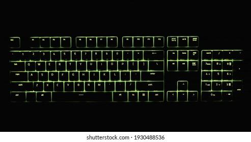 Illuminated keyboard in the dark with RGB lighting closeup