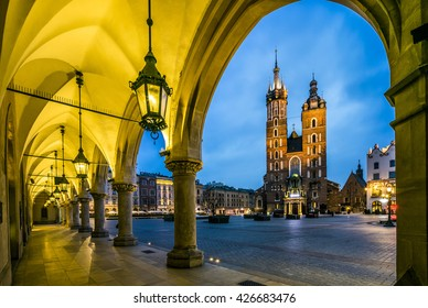 Illuminated Krakow market square at dawn, Poland, Europe