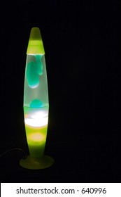 Illuminated Lava Lamp on a black background.  High ISO image(1600!), but fairly low grain.