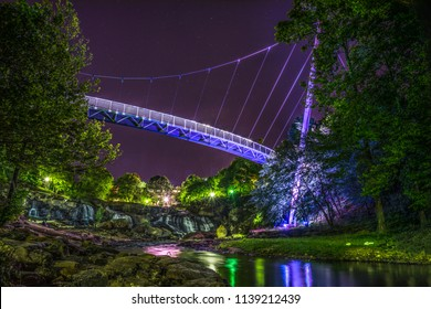 Illuminated Liberty Bridge in Downtown Greenville, South Carolina SC taken from the Reedy River.